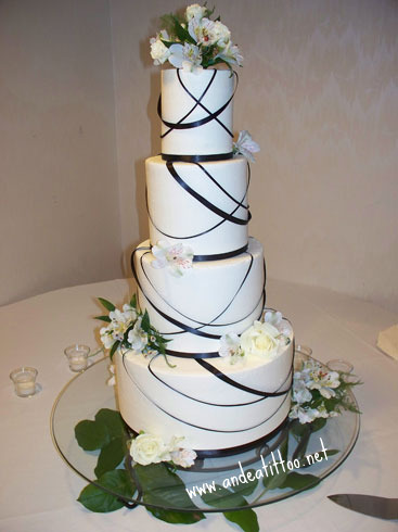 "All Tied Up 2, 12"", 8"" vanilla cake, 6"" & 4"" chocolate rush cake. All red raspberry filled with vanilla butter cream over all. Ribbon is real. Served 100. Recpetion was at the Greenbriar Conference & Party Center in Wooster."