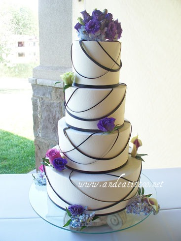 "All Tied Up 3. 14"" & 8"" almond cake, 10"" & 6"" red velvet cake, all cream cheese filled. Vanilla butter cream over all. Served 152. Reception was held at Gervasi Vineyard in canton."