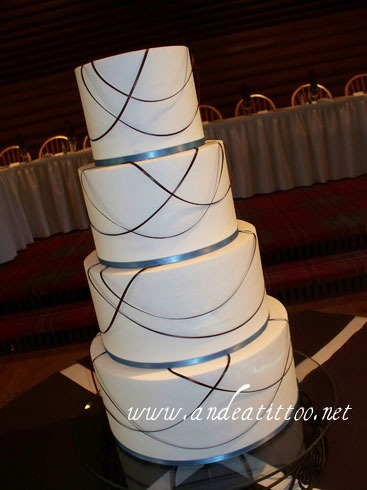 "All Tied Up 4, 12"", 10"", 8"" & 6"", all almond cake filled with raspberry, creme de cacao butter cream over all. Real brown & blue ribbon. Served 130. Reception was held at Fieldcrest Lodge in North Canton."