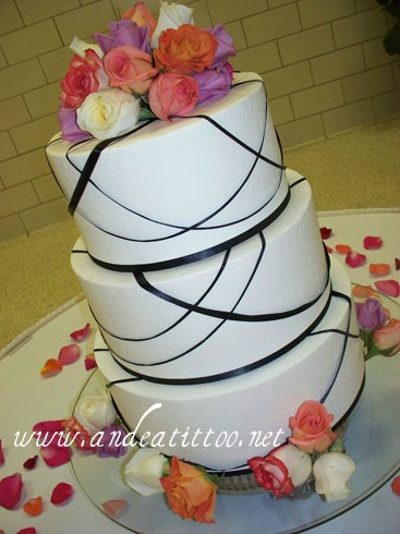 "All Tied Up 5. 14"", 12"" & 10"" all chocolate rush cake filled with kahlua cream cheese. Creme de cacao butter cream over all. Roses & ribbon were real. Served 172. Reception was held at St. George in Cannton."
