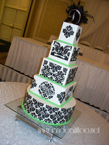 "Black Damask & Green! This is a 16"", 6"" & 4"" almond cake filled with red raspberry. Also an 8"" & 10"" chocolate rush cake, one coconut filled & the other strawberry filled. Creme de cacao butter cream over all. Served 208. The reception was held at The McKinley Grand in Canton."