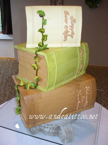 Book Stack Wedding Cake, bottom tier and top tier chocolate rush cake filled w red raspberry, middle tier butter pecan filled w coconut. Vanilla butter cream over all. Served 100. Reception was held at The Inn at Honey Run in Millersburg. www.andeatittoo.net