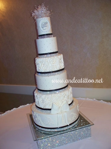 "Justine's Cake! This is a 16"", 10"" & 4"" butter pecan cake, and a 12"", 8"" & 6"" chocolate rush cake. All frosted & filled with dark rum butter cream. Served 238. It looks like it's leaning but it isn't. Wedding and reception were held at The McKinley Grand Hotel in downtown Canton."
