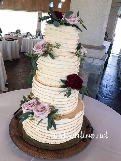 "Justine's cake! This was a 14"" and 6"" apricot pudding cake, and a 10"" and 8"" chocolate stout cake all filled and iced with burnt sugar butter cream. Fresh flowers . Served 152. The reception was held at Gervasi Vineyard in Canton."