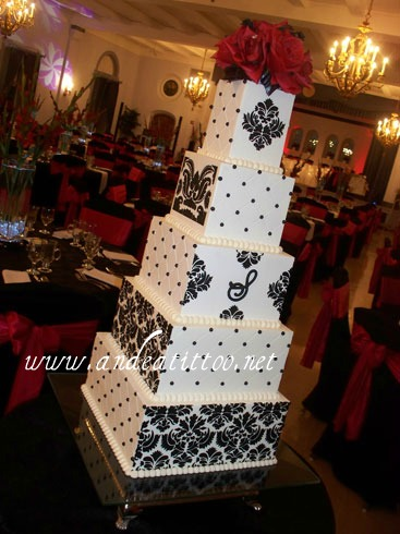 "Laura's Damask & Quilt Cake. 12"" & 8"" are almond cake filled with vanilla bavarian cream. 10"", 6"" & 4"" are apricot pudding cake filled with apricot, 6"" is filled with strawberry. Creme de cacao butter cream over all. Topper is silk. Served 180. Reception was held at The Metropolitan Center in Downtown Canton."