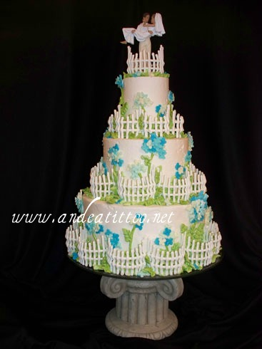 """Picket Fences"", 4"", 8"" & 12"", Serves 88. Royal icing fencing. Another dummy cake."