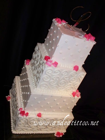 "Quilted, Scrolls n Roses. 12"", 10"" & 8"" almond cake, 12 & 8 raspberry filled, 10 chocolate bavarain cream filed. 6"" chocolate rush cake torted & filled with butter cream. Creme de cacao butter cream over all. Roses are buttercream, pearls are candy. Served 154. Reception was held at Foltz Community Canter in East Canton."