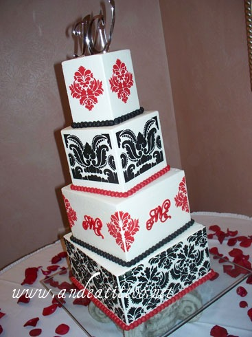 "Red & Black Damask! 10"" & 6"" tiers are chocolate rush cake filled with raspberry, 8"" & 4"" are red velvet filled with vanilla butter cream. Vanilla butter cream over all. Served 108. Reception was held at la Pizzaria in Canton."