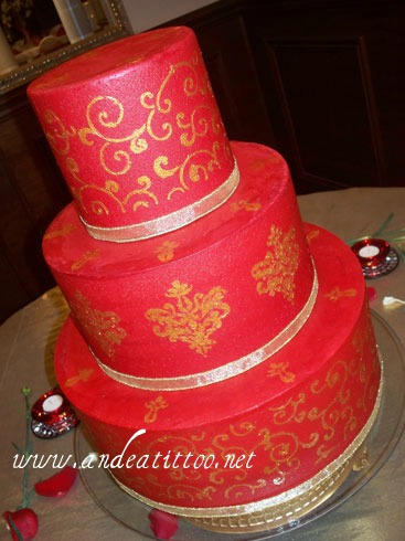 "Red & Gold. 14"" & 6"" strawberry cake filled with vanilla bavarian cream. 10"" almond cake filled with red raspberry. Vanilla butter cream over all. Served 128. Reception was held at Perry Heights Party Center in Canton."