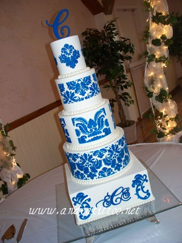 "Todays cake, Royal Damask. 12"", 8"" 4"" are apricot pudding cake, filled with apricot. 10"" & 6"" are butter pecan cake, 10"" strawberry filled, 6"" cherry filled. Creme de cacao butter cream over all. Damask designs are stencilled on. Served 154. Reception was held at Spring Lake Party Center in Lakemore, Ohio."